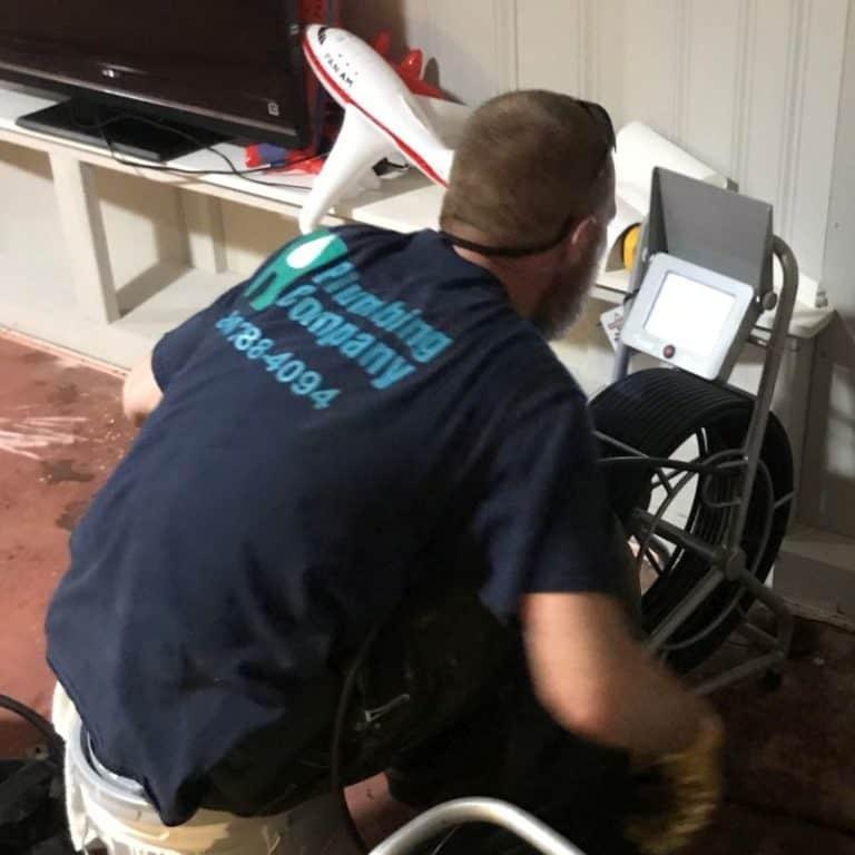 Photo of Tech operating drain camera